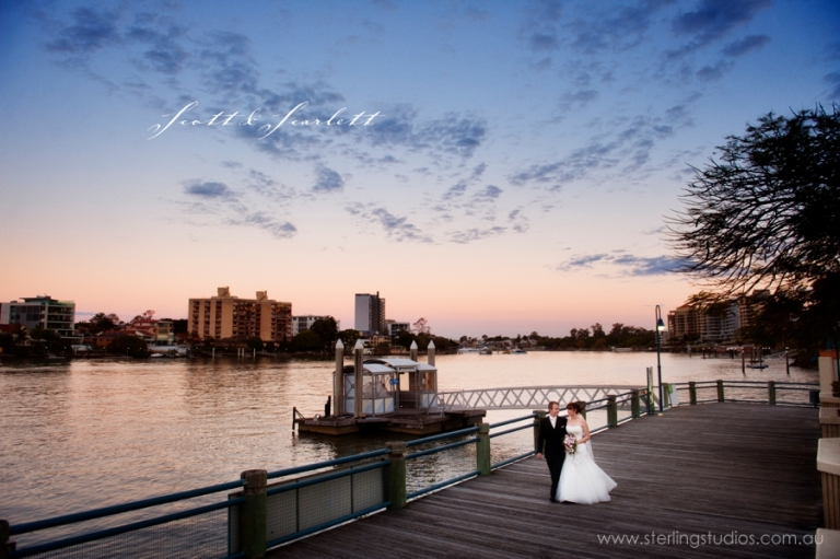 landing at dockside wedding bride and groom on the boardwalk at sunset