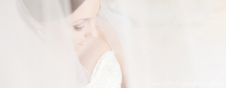 bride with long veil at sanctuary cove wedding